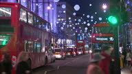 Exterior shots of Christmas Lights and decorations on Oxford Street with Christmas Shoppers going about their business on December 20 2014 in London...