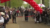 Exterior shots of Claire Lomas walking with crutches across the finishing line of the London marathon wearing a bionic suit Claire Lomas Finishes...