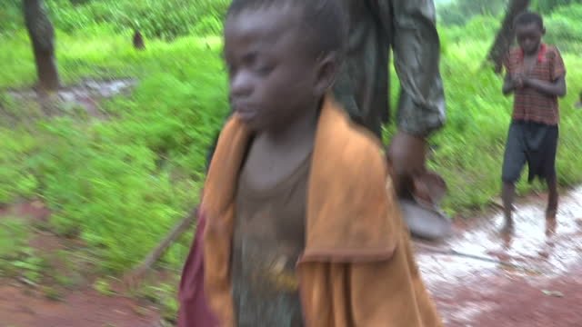 Exterior shots of cobalt miners including children walk from the mines children walking bare foot on February 27 2017 in Democratic Republic of Congo