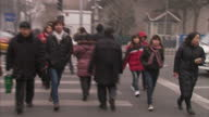 Exterior shots of commuters in Beijing wearing anti smog face masks Beijing commuters wearing anti smog masks on January 30 2013 in Beijing China
