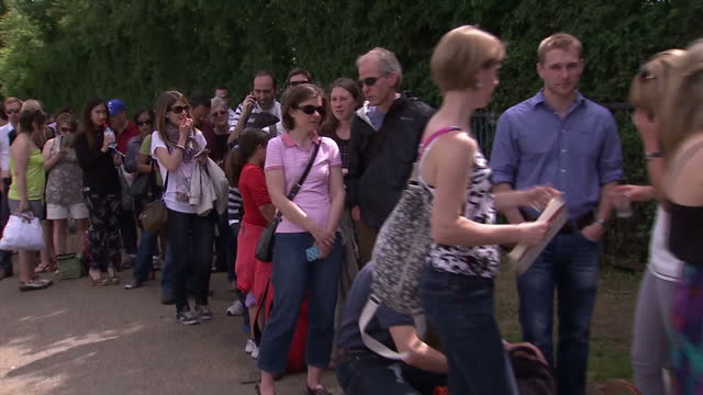 Exterior shots of crowd of people in queue line waiting for Wimbledon tickets Long queue at Wimbledon for tickets at Wimbledon on June 25 2013 in...