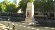 Exterior shots of crowds gathered on Whitehall for the Remembrance Sunday service at the Cenotaph showing the memorial to the Women of World War II...
