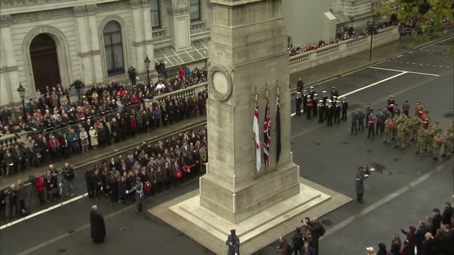 Exterior shots of crowds marking Armistice Day at the Cenotaph in Whitehall standing silently as the Last Post is played at 11 o'clock on November 11...