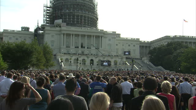 Exterior shots of crowds of people stood outside the Capitol Building watching big screens as Pope Francis delivers a speech to Congress on September...