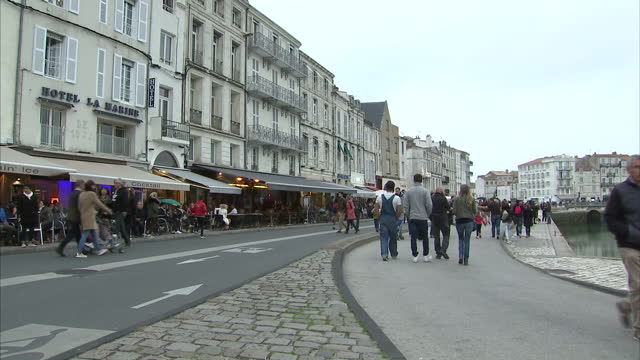 Exterior shots of crowds of tourists milling around in the old harbour area on 31 October 2017 in La Rochelle France