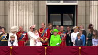 Exterior shots of crowds outside Buckingham Palace cheering at the National Anthem is played the Queen and members of the Royal Family including...