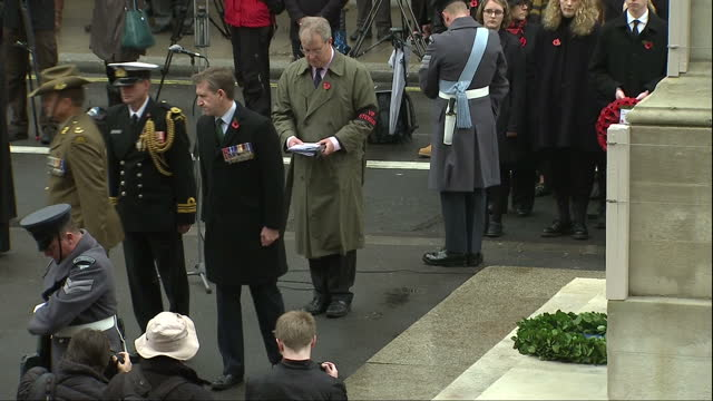 Exterior shots of crowds reflecting silently during Armistice Day commemorations at the Cenotaph and officials laying wreaths on November 11 2017 in...