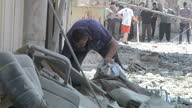 Exterior shots of damaged collapsed buildings and a man clearing up rubble from an attacked mosque on July 23 2014 in Gaza Israel