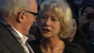 Exterior shots of Dame Helen Mirren and Sir Anthony Hopkins posing on red carpet Close ups of Anthony Hopkins wearing glasses smiling standing with...