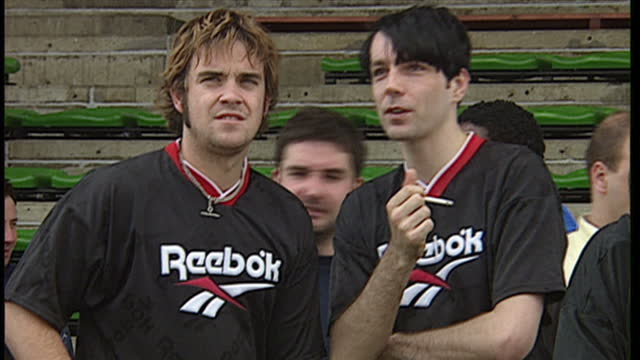 Exterior shots of Damon Albarn Liam Gallagher and Robbie Williams playing in Soccer Six charity football tournament at Mile End Stadium on May 11...