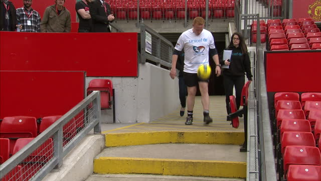 Exterior shots of Dan Magness breaking world record of keepy uppys from London to Manchester Dan Magness enters Old Trafford football stadium doing...