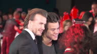 Exterior shots of David Beckham and Harry Styles speaking to the press and posing for photographs together on the red carpet at the premiere of 'The...