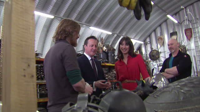 Exterior shots of David Cameron and Samantha Cameron being shown round the Game Of Thrones set being shown various props used in filming on April 07...