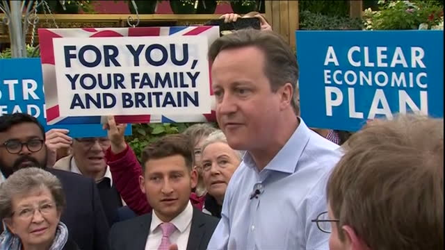 Exterior shots of David Cameron being heckled as he speaks to Tory supporters on a visit to a garden centre in Fulwell on May 5 2015 in London England