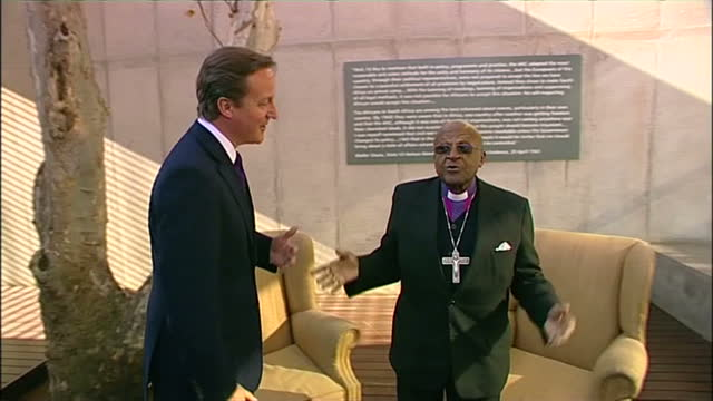 Exterior shots of David Cameron meeting Archbishop Desmond Tutu in Johannesburg before taking seat next to him and chatting on July 07 2011 in...