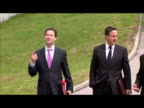 exterior shots of David Cameron Prime Minister and Nick Clegg Deputy Prime Minister walk towards Grattan Stadium where the coalition cabinet are...