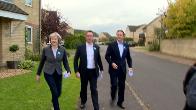 Exterior shots of David Cameron Theresa May and Witney byelection candidate Robert Courts campaigning doortodoor on October 15 2016 in Witney England