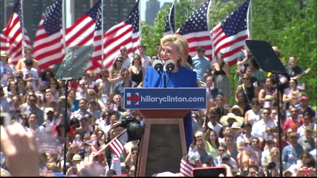 Exterior shots of Democratic presidential candidate Hillary Clinton speaking at a podium at an election campaign rally on June 13 2015 in New York
