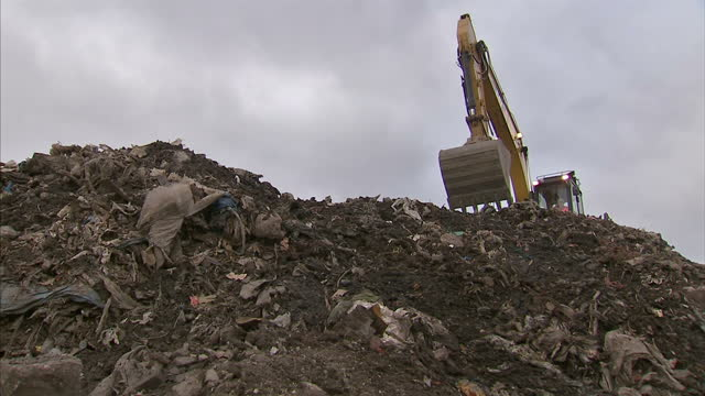 Exterior shots of diggers clearing rubbish and waste from a landfill site on February 02 2016 in Manchester England