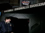 Exterior shots of Dingwalls Dancehall and Samantha's Discotheque in London's Soho area with people hanging about outside including bouncers doormen...