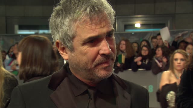 Exterior shots of director Alfonso Cuaron giving an interview on the red carpet on February 16 2014 in London England