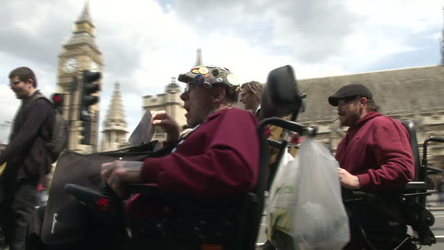 Exterior shots of disability rights campaigners from Disabled People Against Cuts protesting outside the Houses of Parliament>> on June 24 2015 in...
