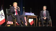 Exterior shots of Donald Trump speaking at Gerald W Kirn Middle School on trade with China and his plans to build a wall across the Mexican border on...