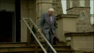 Exterior shots of Dr Ian Paisley departing Stormont as First Minister for the last time before handing over job to Martin McGuiness waving to press...