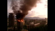 Exterior shots of dramatic explosions and shelling and shots of the 'Momo' and 'Uzeir' twin towers burning on June 08 1992 in Sarajevo Bosnia and...