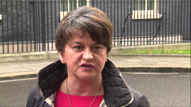 Exterior shots of DUP leader Arlene Foster and deputy leader Nigel Dodds walking out of Number 10 Downing Street and speaking to members of the media...