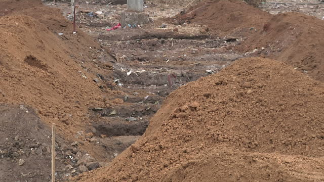 Exterior shots of Ebola burial teams being disinfected and taking off protective wear and empty burial site for Ebola victims on December 18 2014 in...