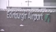 Exterior shots of Edinburgh Airport signage Exterior shots of snow covered Edinburgh airport with stationary planes on tarmac Heavy Snowfall Causes...