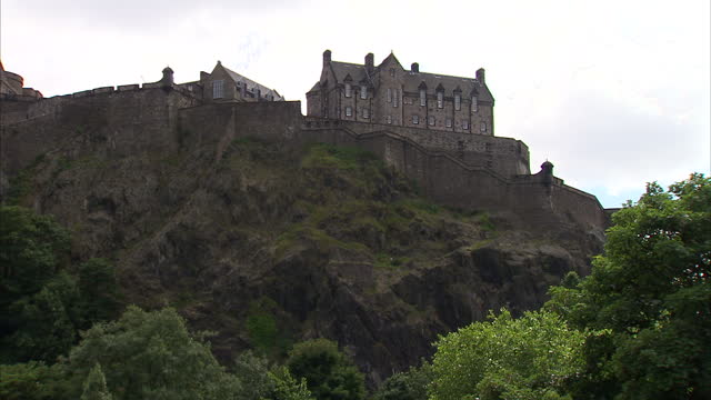 Exterior shots of Edinburgh Castle Princes Street gardens Princes Street the unfinished acropolis Nelson's monument on Calton Hill Shot in Summer...