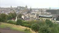 Exterior shots of Edinburgh streetscenes and skyline as seen from Calton Hill with the Clock tower over Balmoral Hotel and Waverly Station Edinburgh...