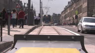 Exterior shots of Edinburgh Trams driving down Princes Street on the first day of their launch on May 31 2014 in Edinburgh Scotland