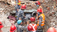 Exterior shots of emergency rescue teams searching underneath rubble from buildings after an earthquake hit the area Filmed on April 30 2015 in...