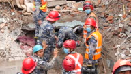Exterior shots of emergency rescue workers clambering over rubble and digging for survivors in the wake of the April 25 Nepalese earthquake on April...