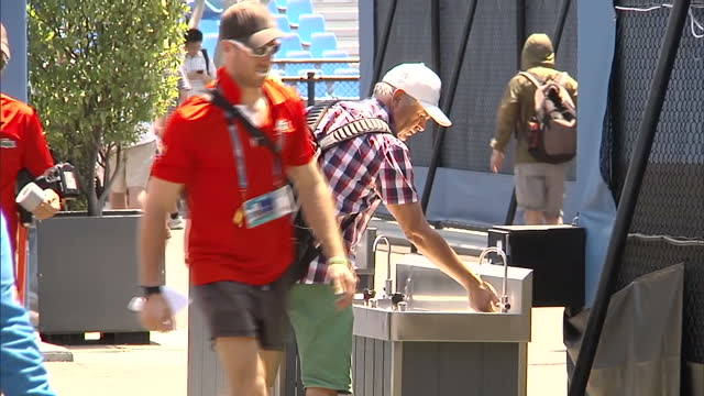 Exterior shots of empty tennis courts and seating stands after the suspension of play on outdoor courts at the Australian Open and staff and...