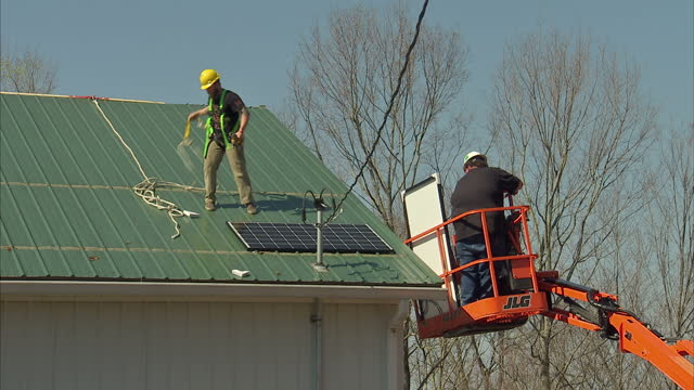 Exterior shots of engineers fitting solar panels to a building on 20 April 2017 in Hazard Kentucky
