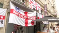 Exterior shots of England Slovakia football fans being served pints of lager wearing St George's flags and celebrating ahead of the Euro 2016...