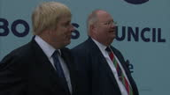 Exterior shots of Eric Pickles and Mayor of London Boris Johnson at the launch of a Conservative party billboard campaign attacking Labour's record...