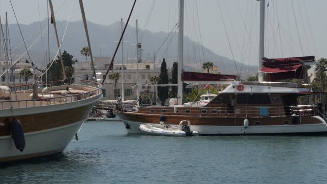 Exterior shots of expensive luxury yachts moored in the harbour area on Kos on August 16 2015 in Kos Greece