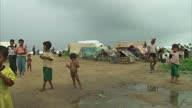 Exterior shots of families and children at an UNHCR refugee camp on June 8 2013 in Sittwe Burma