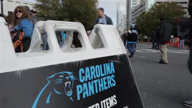 Exterior shots of fans walking around outside the Bank of America Stadium in Charlotte North Carolina on Game Day between the Carolina Panthers and...