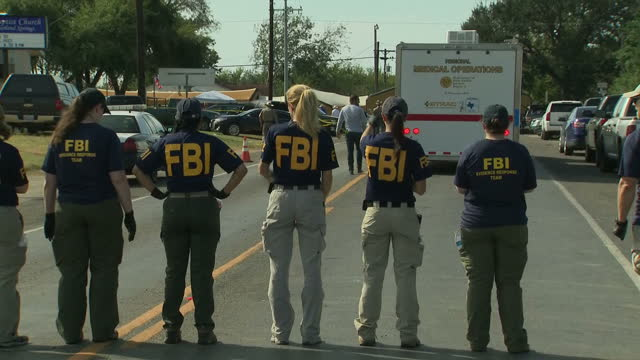 Exterior shots of FBI personnel examining the road outside the First Baptist Church of Sutherland Springs where 26 people were killed when gunman...