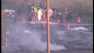 Exterior shots of fire fighters at the scene of Air France Flight 4590 Concorde wreckage hoses of water spraying flames from hotel and aircraft fire...