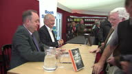 Exterior shots of First Minister Alex Salmond and Sir Tom Devine signing 'The Scottish Nation' books at the book festival on August 11 2014 in...
