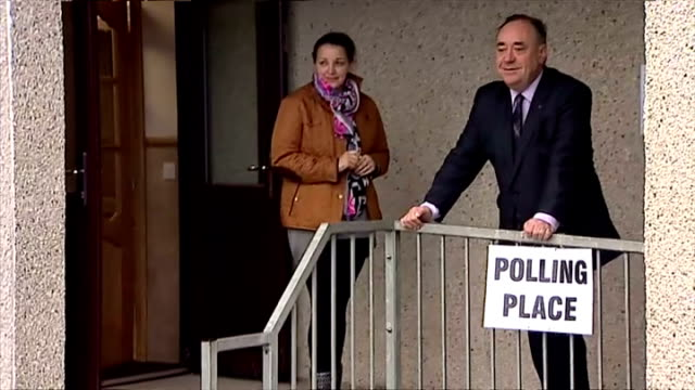 Exterior shots of First Minister Alex Salmond exiting polling station after voting and posing for photo op on September 18 2014 in Strichen Scotland