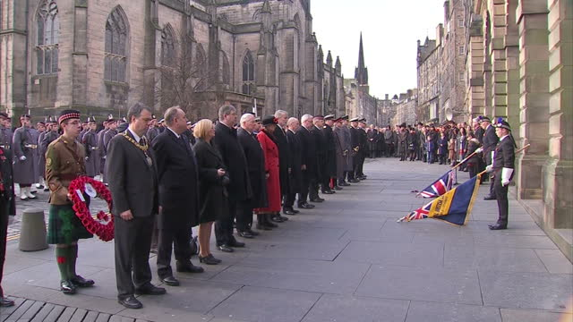 Exterior shots of flags being lowered to observe a minute silence on remembrance day on November 9 2014 in Edinburgh Scotland