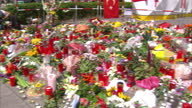 Exterior shots of floral tributes and people mourning at the scene of terror attacks in Munich in which nine people were killed by a teenage gunman...